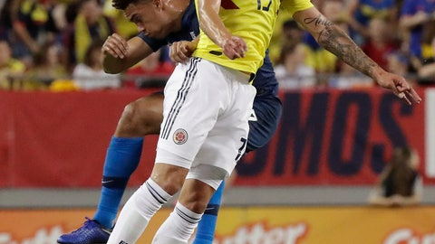 <p>               Colombia midfielder Mateus Uribe (15) goes up for a header against United States' Antonee Robinson, left, during the first half of an international friendly soccer match Thursday, Oct. 11, 2018, in Tampa, Fla. (AP Photo/John Raoux)             </p>