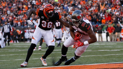 <p>               Tampa Bay Buccaneers tight end O.J. Howard (80) scores a touchdown in front of Cincinnati Bengals strong safety Shawn Williams (36) during the second half of an NFL football game in Cincinnati, Sunday, Oct. 28, 2018. (AP Photo/Frank Victores)             </p>