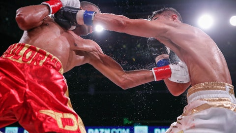 <p>               Thomas Dulorme, left, trades punches with Jessie Vargas during a boxing bout Saturday, Oct. 6, 2018, in Chicago. (AP Photo/Kamil Krzaczynski)             </p>