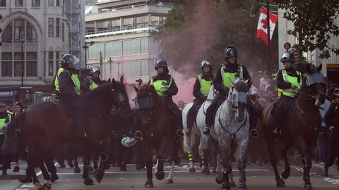 <p>               Mounted police horses react to a flare going off during an anti-fascist demonstration held in protest against a rival march by the Football Lads Alliance march, London, Saturday, Oct. 13, 2018. (AP Photo/Alastair Grant)             </p>