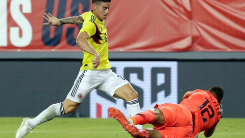 <p>               U.S. goalkeeper Zack Steffen (12) blocks a shot by Colombia's James Rodriguez, left, during the first half of an international friendly soccer match Thursday, Oct. 11, 2018, in Tampa, Fla. (AP Photo/John Raoux)             </p>