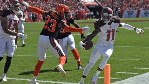 <p>               Tampa Bay Buccaneers wide receiver DeSean Jackson (11) steps around Cleveland Browns strong safety Damarious Randall (23) on an 11-yard touchdown run during the first half of an NFL football game Sunday, Oct. 21, 2018, in Tampa, Fla. (AP Photo/Jason Behnken)             </p>