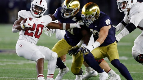 <p>               FILE - In this Sept. 29, 2018, file photo, Stanford running back Bryce Love (20) is stopped by Notre Dame linebackers Te'von Coney (4) and Drue Tranquill (23) during the second half of an NCAA college football game in South Bend, Ind. Love has struggled to get going this year for Stanford. He is averaging 4.3  yards per carry, down from a mark 8.1 a year ago, and already missed one game against UC Davis to heal up some bumps and bruises. He left last week's game against the Irish with an injured ankle and is questionable for this week's game against Utah. (AP Photo/Carlos Osorio, File)             </p>