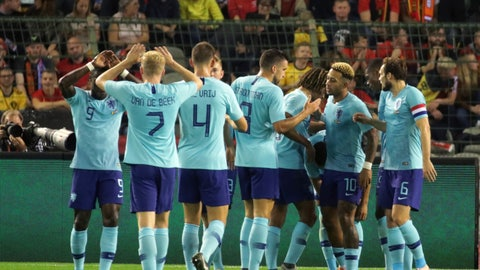 <p>               Netherlands' players celebrate the first goal of their team during an international soccer friendly match between Belgium and The Netherlands at the King Baudouin stadium in Brussels, Tuesday, Oct. 16, 2018. (AP Photo/Olivier Matthys)             </p>
