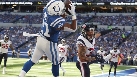 <p>               Indianapolis Colts' Nyheim Hines (21) makes a touchdown reception against Houston Texans' Tyrann Mathieu (32) during the second half of an NFL football game, Sunday, Sept. 30, 2018, in Indianapolis. (AP Photo/Michael Conroy)             </p>