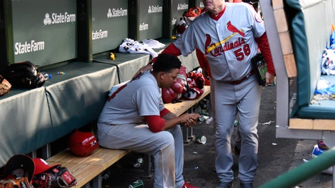 <p>               St. Louis Cardinals shortstop Yairo Munoz, seated, gets a pat on the back from batting coach Mark Budaska (58) after a baseball game against the Chicago Cubs on Sunday, Sept. 30, 2018, in Chicago. The Chicago Cubs won 10-5. (AP Photo/Matt Marton)             </p>