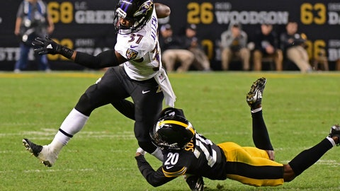 <p>               Baltimore Ravens running back Javorius Allen (37) slips the tackle by Pittsburgh Steelers cornerback Cameron Sutton (20) during the second half of an NFL football game in Pittsburgh, Sunday, Sept. 30, 2018. (AP Photo/Fred Vuich)             </p>