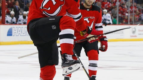 <p>               FILE - In this Oct. 14, 2018, file photo, New Jersey Devils right wing Kyle Palmieri celebrates after scoring a goal against the San Jose Sharks during the second period of an NHL hockey game, in Newark,N.J. Less than a month into the season, it looks like the Devils are ready to take the next step after making the playoffs for the first time since reaching the Stanley Cup Finals in 2012. Palmieri is among the league leaders with eight goals. (AP Photo/ Noah K. Murray, File)             </p>
