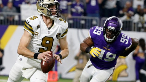 <p>               New Orleans Saints quarterback Drew Brees runs from Minnesota Vikings defensive end Danielle Hunter, right, during the second half of an NFL football game, Sunday, Oct. 28, 2018, in Minneapolis. (AP Photo/Bruce Kluckhohn)             </p>