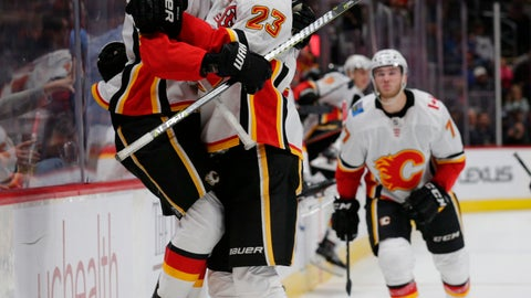 <p>               Calgary Flames left wing Johnny Gaudreau (13) leaps into center Sean Monahan's arms after Gaudreau scored in overtime of an NHL hockey game against the Colorado Avalanche on Saturday, Oct. 13, 2018, in Denver. Calgary won 3-2. (AP Photo/Joe Mahoney)             </p>