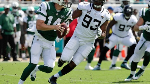 <p>               New York Jets quarterback Sam Darnold, left, looks for a receiver as he is pressured by Jacksonville Jaguars defensive tackle Calais Campbell (93) during the first half of an NFL football game Sunday, Sept. 30, 2018, in Jacksonville, Fla. (AP Photo/John Raoux)             </p>