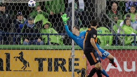 <p>               Houston Dynamo goalkeeper Joe Willis reaches for but cannot get to a goal kicked by Seattle Sounders forward Will Bruin (not shown) as Dynamo's Andrew Wenger looks on during the first half of an MLS soccer match Monday, Oct. 8, 2018, in Seattle. (AP Photo/Ted S. Warren)             </p>
