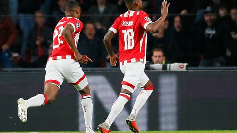 <p>               PSV's Denzel Dumfries, left, celebrates with teammate Pablo Rosario, right, who scored his side's first goal during a Group B Champions League soccer match between PSV and Inter Milan at the Philips stadium in Eindhoven, Netherlands, Wednesday, Oct. 3, 2018. (AP Photo/Peter Dejong)             </p>