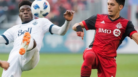 <p>               Vancouver Whitecaps forward Alphonso Davies, left, battles for the ball giants Toronto FC midfielder Marco Delgado (18) during the first first half of a MLS soccer game, Saturday, Oct. 6, 2018 in Toronto. (Nathan Denette/Canadian Press via AP)             </p>