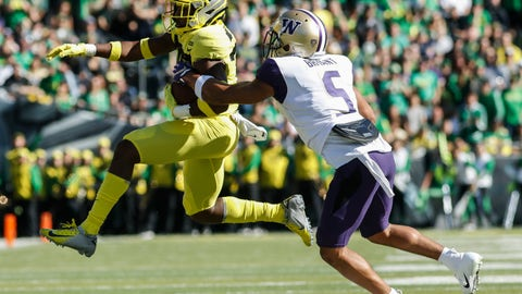 <p>               Oregon wide receiver Jaylon Redd (30), outruns Washington defensive back Myles Bryant (5), during an NCAA college football game in Eugene, Ore., Saturday, Oct. 13, 2018. (AP Photo/Thomas Boyd)             </p>