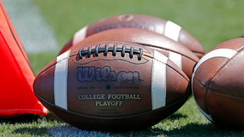"""<p>               FILE - In this Sept. 2, 2017, file photo, footballs sit on the turf ready for kick-off before the start of an NCAA football game between South Carolina and North Carolina State in Charlotte, N.C. A study from The Institute for Diversity and Ethics (TIDES) finds that white men still """"overwhelmingly"""" fill leadership positions at top-level college sports programs and conferences, leaving a """"consistent underrepresentation of women and people of color"""" in those roles. (AP Photo/Bob Leverone, File)             </p>"""