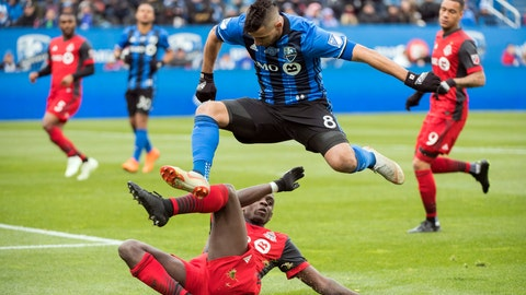 <p>               Montreal Impact's Saphir Taider (8) leaps over Toronto FC's Chris Mavinga during first-half MLS soccer game action in Montreal, Sunday, Oct. 21, 2018. (Graham Hughes/The Canadian Press via AP)             </p>