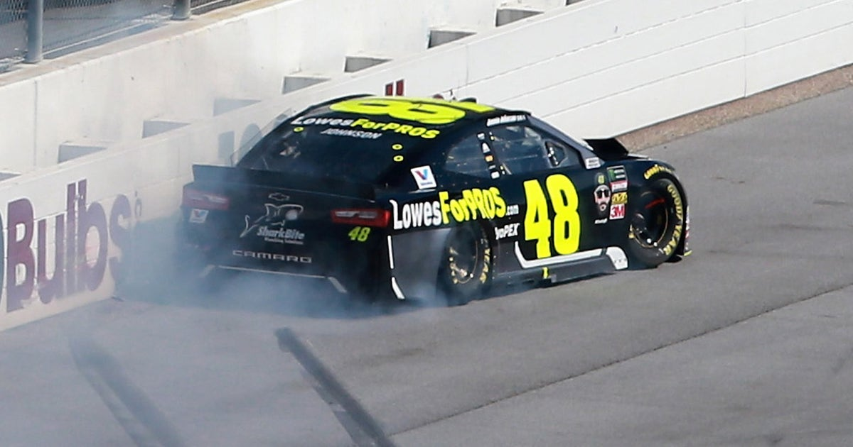 Jimmie Johnson spins in the tri-oval and hits the wall
