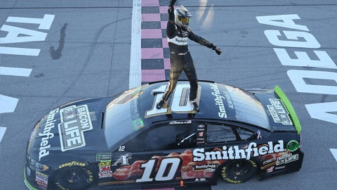 TALLADEGA, AL - OCTOBER 14:  Aric Almirola, driver of the #10 Smithfield Bacon for Life Ford, celebrates after winning the Monster Energy NASCAR Cup Series 1000Bulbs.com 500 at Talladega Superspeedway on October 14, 2018 in Talladega, Alabama.  (Photo by Matt Sullivan/Getty Images)