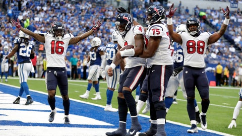 <p>               Houston Texans quarterback Deshaun Watson (4) celebrates a touchdown with Martinas Rankin (75), Keke Coutee (16) and Jordan Akins (88) during the second half of an NFL football game against the Indianapolis Colts, Sunday, Sept. 30, 2018, in Indianapolis. (AP Photo/Michael Conroy)             </p>