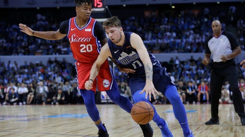<p>               Luka Doncic of the Dallas Mavericks, right, controls the ball past Markelle Fultz of the Philadelphia 76ers, during the Shenzhen basketball match between the Philadelphia 76ers and the Dallas Maverick, part of the NBA China Games, in Shenzhen city, south China's Guangdong province, Monday, Oct. 8, 2018. (AP Photo/Kin Cheung)             </p>