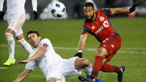 <p>               Toronto FC defender Justin Morrow (2) and Atlanta United defender Michael Parkhurst, left, vie for the ball during the second half of MLS soccer game action in Toronto, Sunday, Oct. 28, 2018. (Cole Burston/The Canadian Press via AP)             </p>