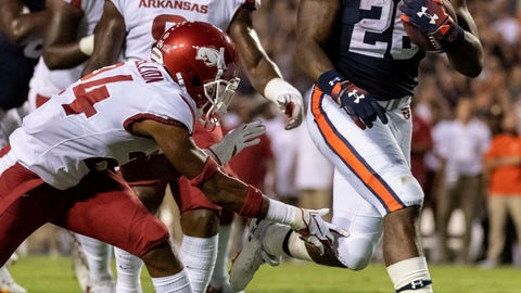 <p>               Auburn running back JaTarvious Whitlow (28) scores a running touchdown past Arkansas defensive back Jarques McClellion (24) during the first half of an NCAA college football game, Saturday, Sept. 22, 2018, in Auburn, Ala. (AP Photo/Vasha Hunt)             </p>