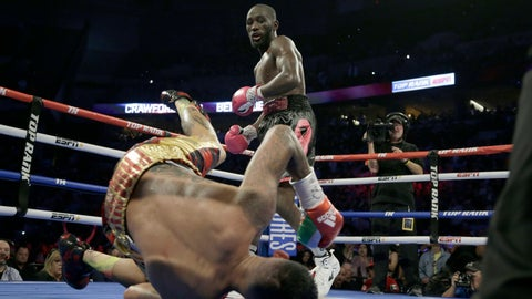 <p>               Terence Crawford watches as Jose Benavidez goes down in the 12th round during their WBO welterweight title boxing bout in Omaha, Neb., Saturday, Oct. 13, 2018. Terence Crawford won in the 12th round. (AP Photo/Nati Harnik)             </p>
