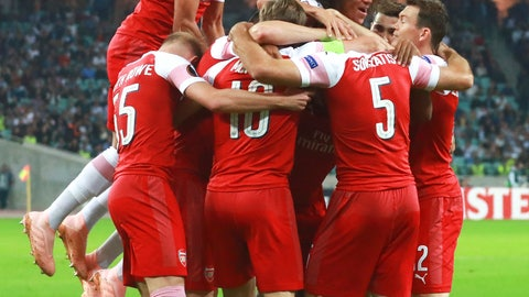 <p>               Arsenal's players celebrate after scoring the opening goal during a Group E Europa League soccer match between Qarabag FK and Arsenal at the Olympic stadium in Baku, Azerbaijan, Thursday, Oct. 4, 2018. (AP Photo/Aziz Karimov)             </p>