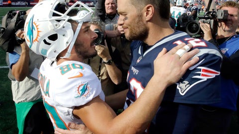 <p>               Miami Dolphins wide receiver Danny Amendola, left, and New England Patriots quarterback Tom Brady speak at midfield after an NFL football game, Sunday, Sept. 30, 2018, in Foxborough, Mass. (AP Photo/Steven Senne)             </p>