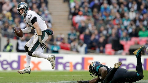 <p>               Philadelphia Eagles quarterback Carson Wentz (11) skips out of a tackle during the second half of an NFL football game against Jacksonville Jaguars at Wembley stadium in London, Sunday, Oct. 28, 2018. (AP Photo/Matt Dunham)             </p>