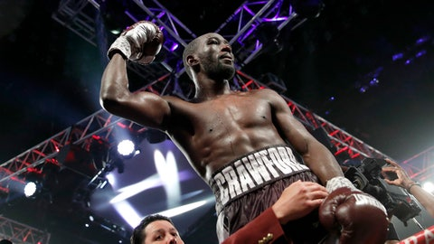 <p>               FILE - In this June 9, 2018, file photo, Terence Crawford celebrates after defeating Jeff Horn, of Australia, in a welterweight title boxing match in Las Vegas. Crawford said he's eager to make unbeaten challenger Jose Benavidez Jr. eat his words when they meet in the ring in Omaha, Neb., on Oct. 13.  (AP Photo/John Locher, File)             </p>