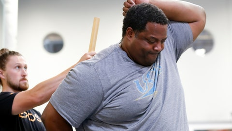 <p>               In this Oct. 8, 2018, photo, former NFL football player Vaughn Parker, right, works with Cole Tomlinson during a range of motion evaluation at Exos in Carlsbad, Calif. Parker played for the San Diego Chargers and Washington Redskins during his time in the NFL. (AP Photo/Gregory Bull)             </p>