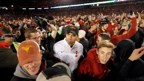 <p>               Iowa State head coach Matt Campbell, center, celebrates with fans on the field after an NCAA college football game against West Virginia, Saturday, Oct. 13, 2018, in Ames, Iowa. (AP Photo/Charlie Neibergall)             </p>