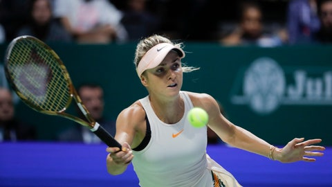 <p>               Ukraine's Elina Svitolina returns a shot from Petra Kvitova of the Czech Republic during their match at the WTA tennis finals in Singapore, Sunday, Oct. 21, 2018. (AP Photo/Vincent Thian)             </p>