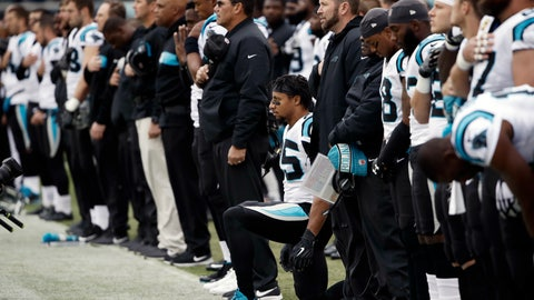 <p>               Carolina Panthers strong safety Eric Reid, center, takes a knee during the playing of the national anthem prior to an NFL football game against the Philadelphia Eagles, Sunday, Oct. 21, 2018, in Philadelphia. (AP Photo/Matt Rourke)             </p>