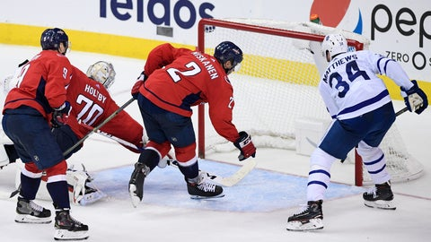 <p>               Toronto Maple Leafs center Auston Matthews (34) scores a goal against Washington Capitals defenseman Dmitry Orlov (9), of Russia, Matt Niskanen (2) and goaltender Braden Holtby (70) during the third period of an NHL hockey game, Saturday, Oct. 13, 2018, in Washington. The Maple Leafs won 4-2. (AP Photo/Nick Wass)             </p>