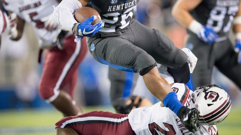 <p>               FILE - In this Sept. 29, 2018, file photo, Kentucky running back Benny Snell Jr. (26) leaps over South Carolina defensive back Jamyest Williams (21) during the first half of an NCAA college football game in Lexington, Ky. The Wildcats average 252 yards rushing per game and Snell accounts for more than half at 127.80, which is good for seventh in the nation. (AP Photo/Bryan Woolston, File)             </p>
