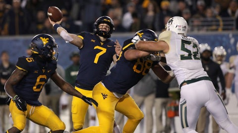 <p>               West Virginia quarterback Will Grier (7) prepares to pass the ball during the first half of an NCAA college football game against Baylor, Thursday, Oct. 25, 2018, in Morgantown,.WVa. (AP Photo/Raymond Thompson             </p>