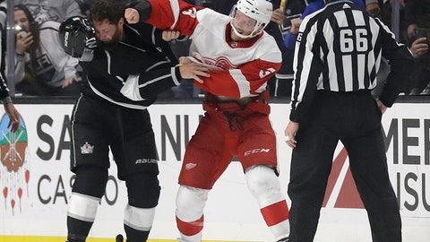 <p>               Detroit Red Wings' Nick Jensen, center, fights with Los Angeles Kings' Jake Muzzin during the second period of an NHL hockey game Sunday, Oct. 7, 2018, in Los Angeles. (AP Photo/Marcio Jose Sanchez)             </p>