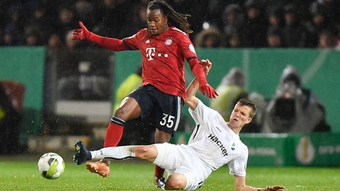 <p>               Roedinghausen's Fabian Kunze, right, and Bayern's Renato Sanches challenge for the ball during the German soccer cup, DFB Pokal, match between the 4th divisioner SV Roedinghausen and Bayern Munich in Osnabrueck, Germany, Tuesday, Oct. 30, 2018. Roedinghausen was defeated by Bayern with only 1-2. (AP Photo/Martin Meissner)             </p>