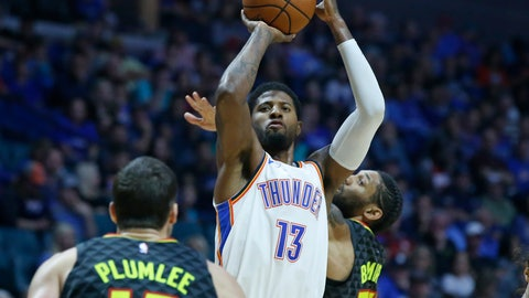 <p>               Oklahoma City Thunder forward Paul George (13) shoots between Atlanta Hawks center Miles Plumlee (18) and forward DeAndre' Bembry (95) in the second half of an NBA preseason basketball game in Tulsa, Okla., Sunday, Oct. 7, 2018. (AP Photo/Sue Ogrocki)             </p>
