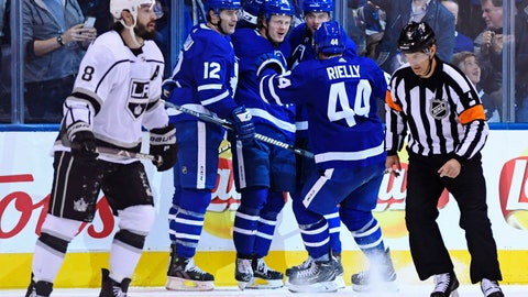 <p>               Toronto Maple Leafs right wing Kasperi Kapanen (24) celebrates his goal with teammates Patrick Marleau (12), Auston Matthews (34) and Morgan Rielly (44) as Los Angeles Kings defenseman Drew Doughty (8) looks on during third period NHL hockey action in Toronto on Monday, Oct. 15, 2018. (Nathan Denette/The Canadian Press via AP)             </p>