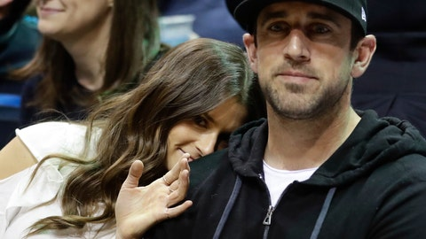 "<p>               FILE - In this April 20, 2018 file photo Danica Patrick and Green Bay Packers' Aaron Rodgers watch during the first half of Game 3 of an NBA basketball first-round playoff series between the Milwaukee Bucks and the Boston Celtics in Milwaukee. Patrick encountered some resistance from Rodgers when she wanted to set up a woman cave in the house they share in Green Bay, Wisconsin. The retired racecar driver proposed converting a bedroom into her own space. She says she got ""shut down"" even though Rodgers has a man cave in the house. (AP Photo/Morry Gash, file)             </p>"