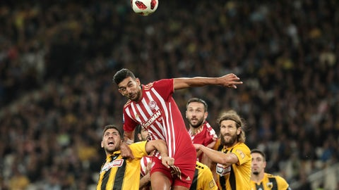 <p>               Olympiakos' Ahmed Hassan, center, tries to score against AEK Athens during their Greek Super League soccer match at Olympic stadium in Athens, Sunday, Oct. 7, 2018. (AP Photo/Yorgos Karahalis)             </p>