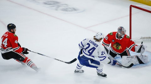 <p>               Toronto Maple Leafs right wing Kasperi Kapanen (24) scores past Chicago Blackhawks goaltender Cam Ward (30) during the first period of an NHL hockey game Sunday, Oct. 7, 2018, in Chicago. (AP Photo/Kamil Krzaczynski)             </p>