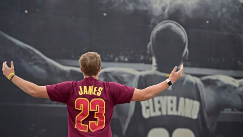<p>               FILE - In this June 8, 2018, file photo, Cleveland Cavaliers fan Seth Lapray poses for a photo in front of a poster featuring Cleveland Cavaliers forward LeBron James, before Game 4 of basketball's NBA Finals between the Cavaliers and the Golden State Warriors, in Cleveland. Relief. None of the Cavs players, coaches or Cleveland front office members would ever use that word in public to describe not having LeBron James. However, there is definitely a sense of freedom that didn't exist while waiting _ and wondering _ about his next move. (AP Photo/David Dermer, File)             </p>