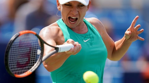 <p>               FILE - In this Sunday, Aug. 19, 2018 file photo, Simona Halep, of Romania, returns to Kiki Bertens, of the Netherlands, during the finals at the Western & Southern Open tennis tournament in Mason, Ohio. Halep is back as the year-end No. 1 for the second year in a row despite a back injury that doctors say could lead to a long-term problem. Halep won her first major title at this year's French Open and has had a consistent season but may be forced to pull out of the upcoming Kremlin Cup and the season-ending WTA Finals because of a herniated disk. (AP Photo/John Minchillo, File)             </p>