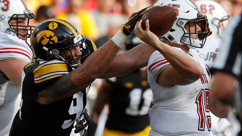 <p>               FILE - In this Sept. 1, 2018, file photo, Iowa defensive end A.J. Epenesa, left, pressures Northern Illinois quarterback Marcus Childers during the second half of an NCAA college football game, in Iowa City, Iowa. Iowa's dominant defensive line will be a major challenge for Minnesota freshman quarterback Zack Annexstad on Saturday, in the latest edition of the Floyd of Rosedale bronze pig trophy game. (AP Photo/Charlie Neibergall, File)             </p>
