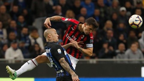 <p>               Inter Milan's Radja Nainggolan, left and AC Milan's Alessio Romagnoli compete for the ball during the Serie A soccer match between Inter Milan and AC Milan at the San Siro Stadium, in Milan, Italy, Sunday, Oct. 21, 2018. (AP Photo/Antonio Calanni)             </p>